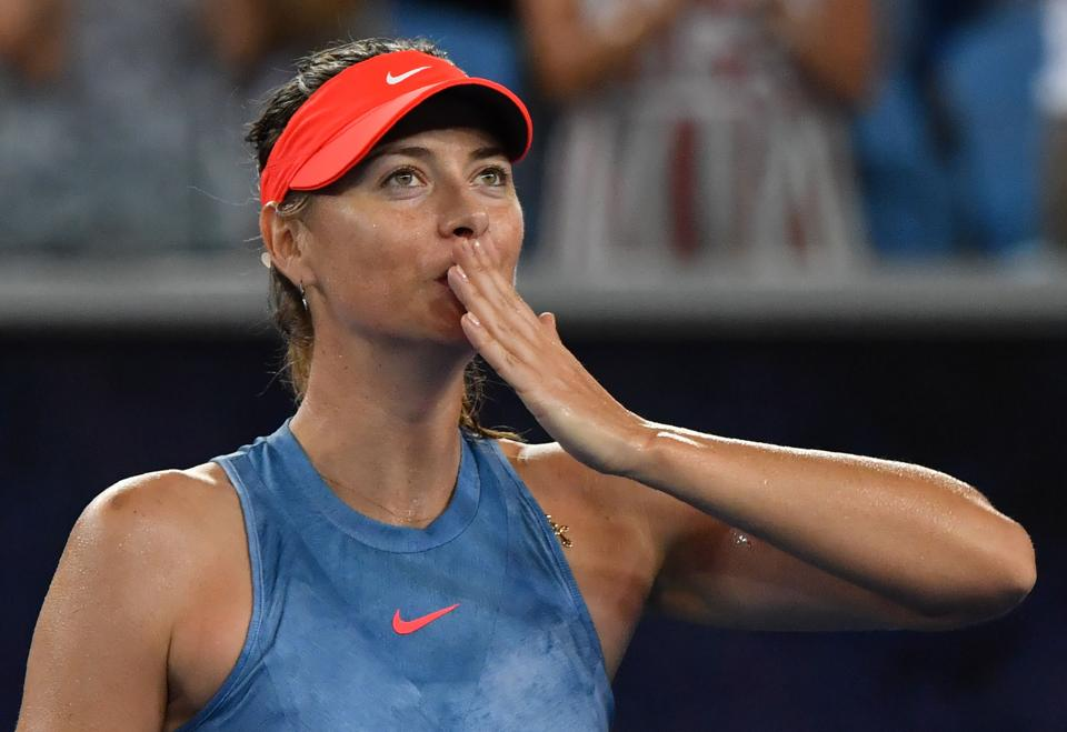 Russia's Maria Sharapova celebrates after victory over Sweden's Rebecca Peterson in their women's singles match on day three of the Australian Open tennis tournament in Melbourne