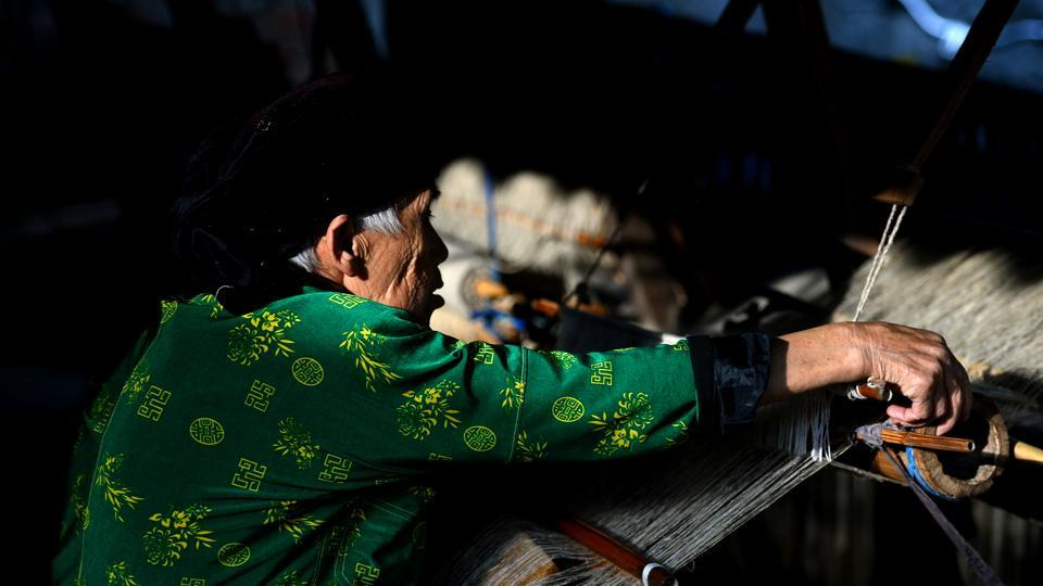 "An eighty-year-old Hmong woman weaves textile. ""If women, especially trafficked women, are working in a group together they make themselves stronger by gaining negotiating power, accelerating knowledge and integrating into society,"" said Nguyen Tien Phong, head of inclusive growth at United Nations Development Programme in Vietnam. (Nhac Nguyen / AFP)"
