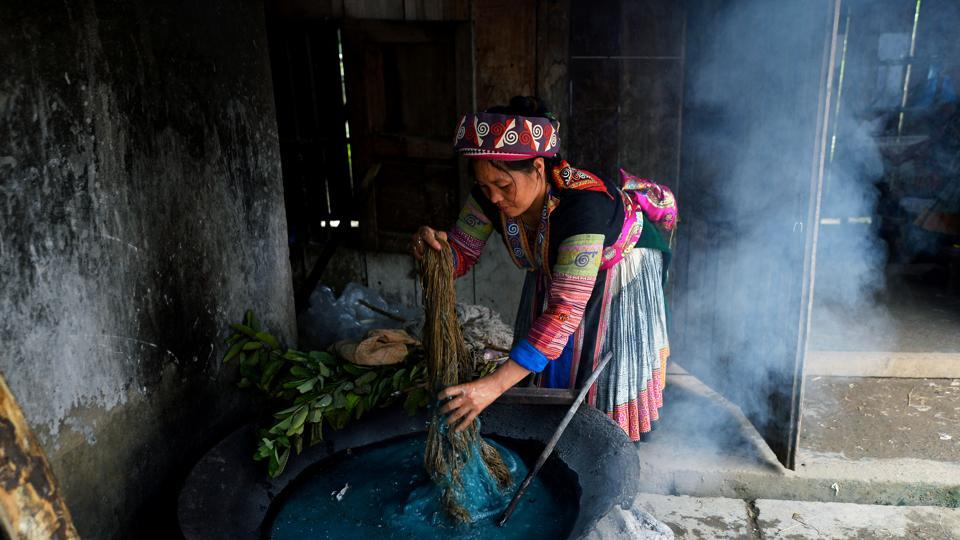 A girl dyes textiles at the Lung Tam Linen cooperative. The collective makes hemp handbags and table runners, coasters and stuffed animals, and the women can earn up to $170 per month, a decent wage in impoverished Ha Giang province. (Nhac Nguyen / AFP)