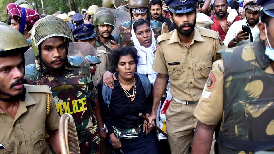 Bindu Ammini and Kanakadurga are escorted by police after they attempted to enter the Sabarimala temple in Pathanamthitta district in the southern state of Kerala in December. They succeeded in enetring the shrine in Januray 2019.