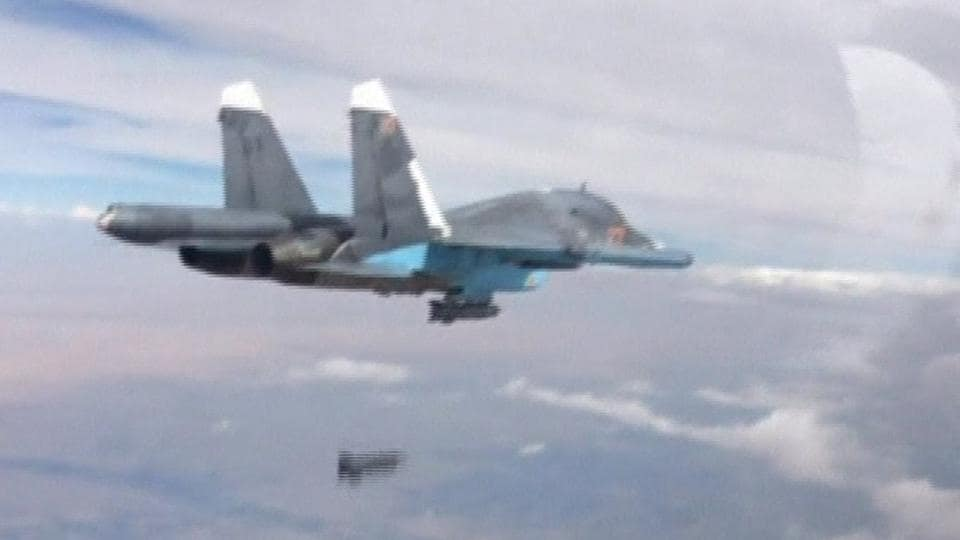 The file photo shows a Russian Su-34 fighter-bomber dropping a bomb in the air over Syria. Two Russian fighter jets have collided in mid-air in the Far East, the Defense Ministry said Friday.