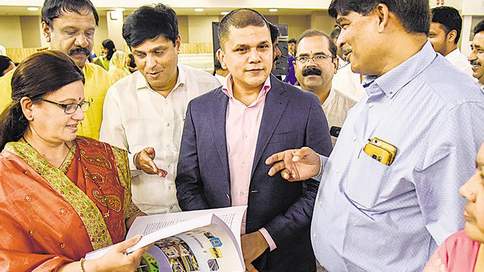 Mukta Tilak (extreme left), mayor, and Saurabh Rao (second from right), Pune municipal commissioner, at the Pune Municipal corporation on Thursday.