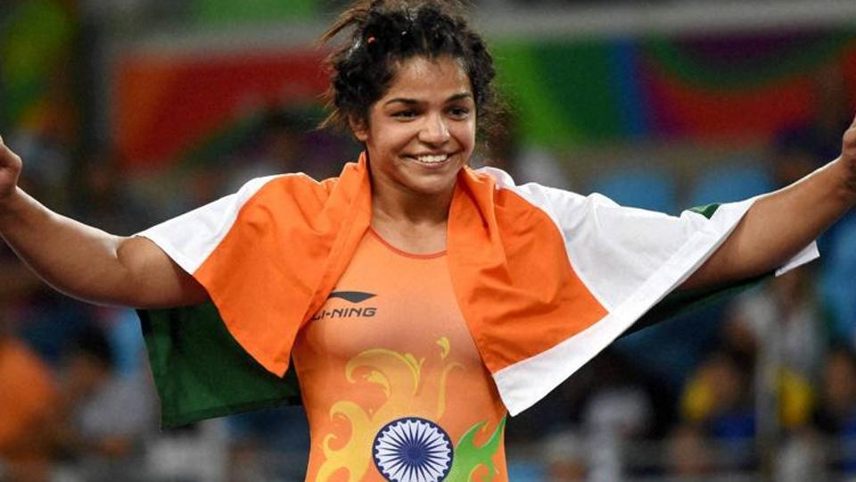Sakshi Malik celebrates after she beat Kyrgyzstan's Aisuluu Tynybekova to win the bronze in the women's wrestling freestyle.