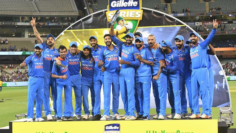 Indian cricket players pose with the trophy. (AP)