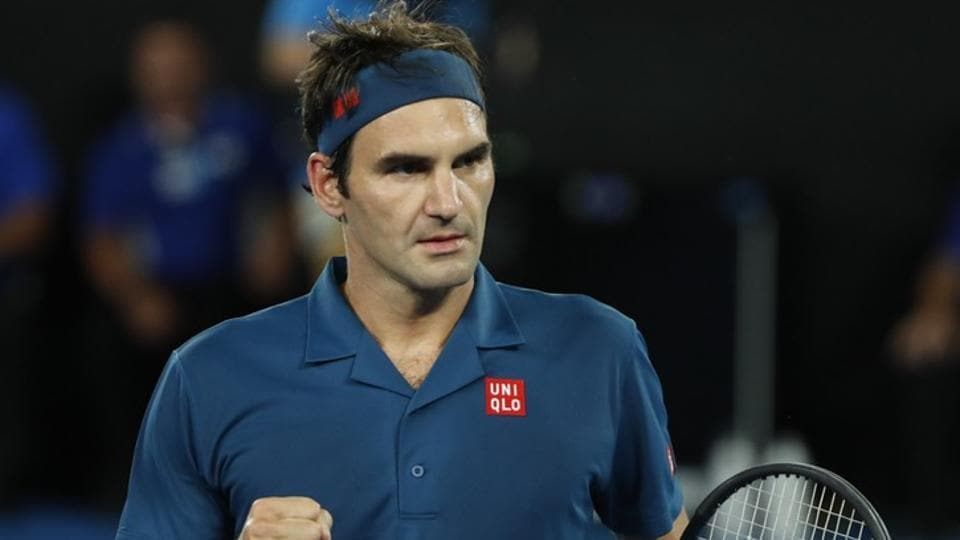 Roger Federer reacts during the match against Taylor Fritz.