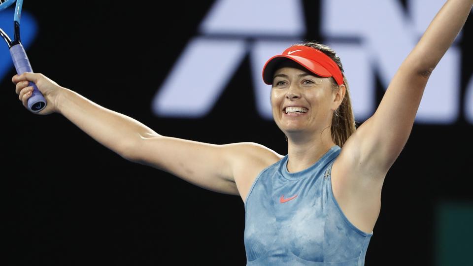 Russia's Maria Sharapova celebrates after winning the match against Denmark's Caroline Wozniacki.