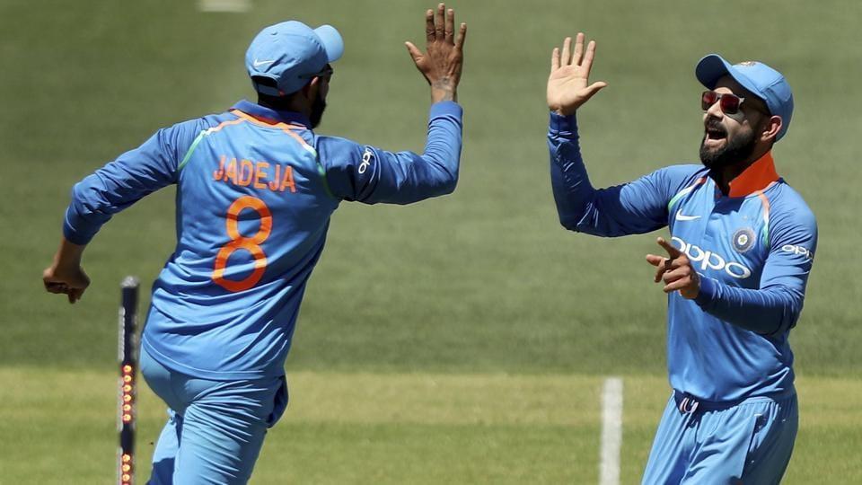 Ravindra Jadeja, left, and Virat Kohli celebrate the wicket of Australia's Usman Khawaja.