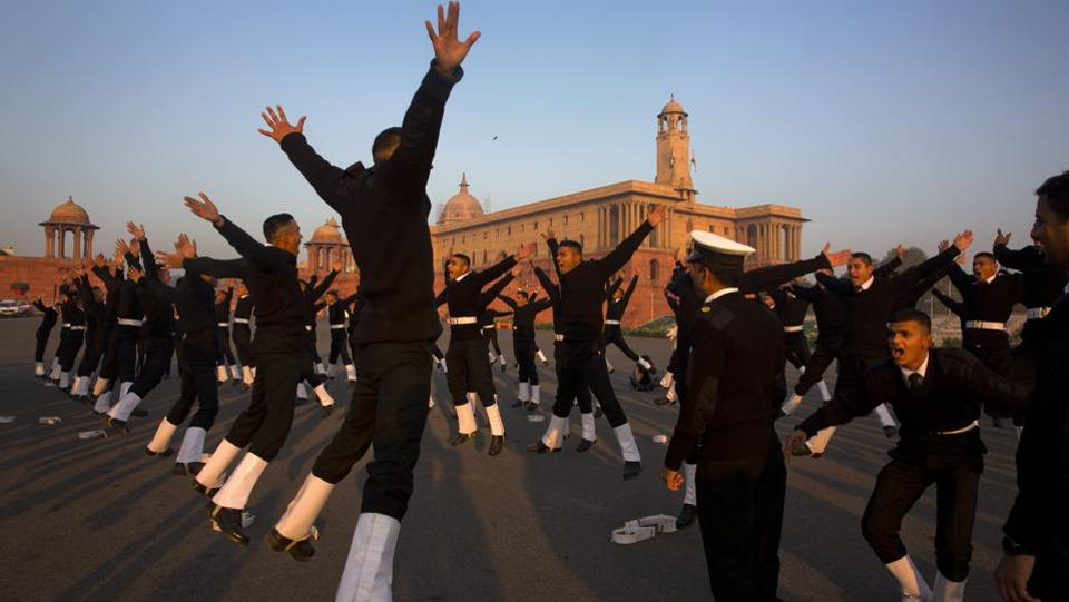 Indian Naval soldiers warm up during rehearsals for the upcoming Republic Day parade at the Raisina Hills in New Delhi. (Manish Swarup / AP)