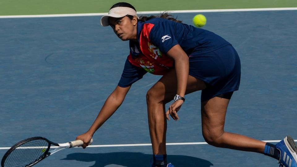 Prerna Vichare of Maharashtra in action during girls Tennis match under 17 category at Khelo India Youth Games.