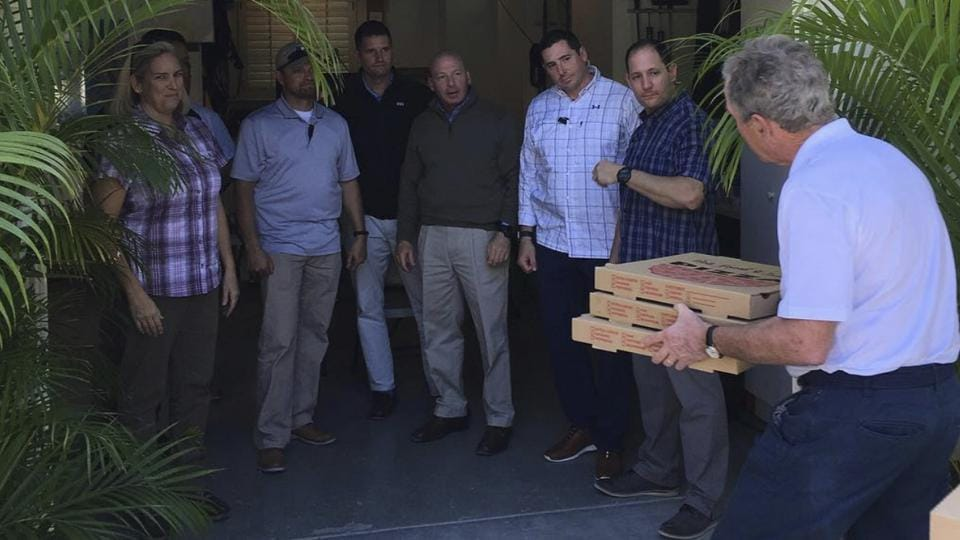 In this undated image posted on former President George W. Bush's Instagram account on Friday, Jan. 19, 2019, Bush, right, delivers pizzas to his secret service detail in Florida.