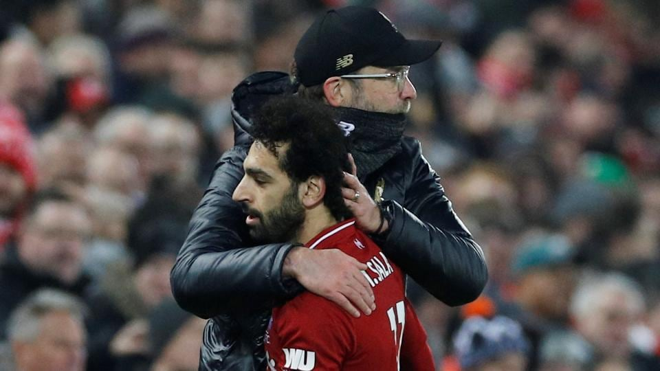 Liverpool's Mohamed Salah is embraced by manager Juergen Klopp.