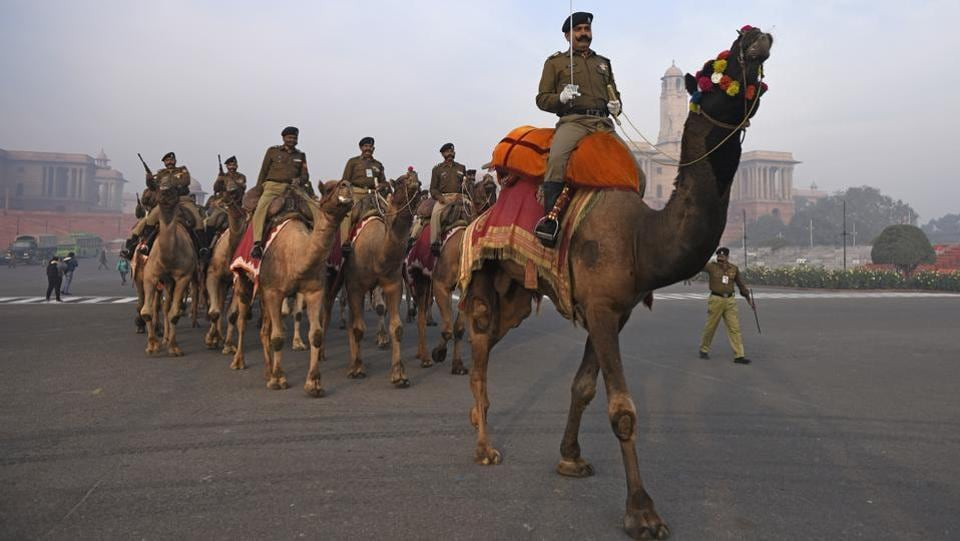 Border Security Force personnel ride on camels during rehearsals ahead of the Republic Day parade, at Vijay chowk, in New Delhi. (Sanchit Khanna / HT Photo)