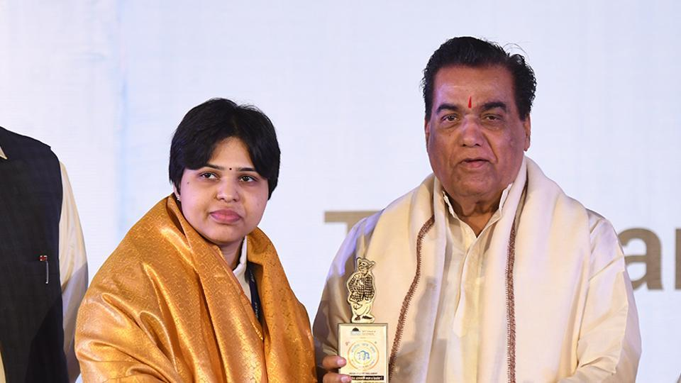 Trupti Desai, women's rights activist, receives an award from Vishwanath Karad, founder and director general, MIT world peace university at the 9th Indian Student Parliament on Saturday.