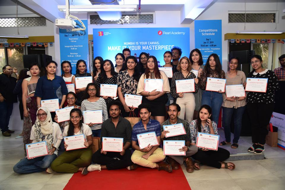 Winners of Mumbai By Design show their certificates.