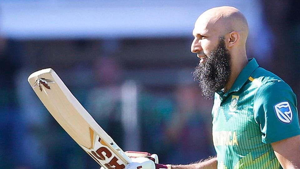 South African batsman Hashim Amla raises his bat as he celebrates scoring a century (100 runs) during the first One Day International (ODI) match between South Africa and Pakistan at St. George's cricket stadium.