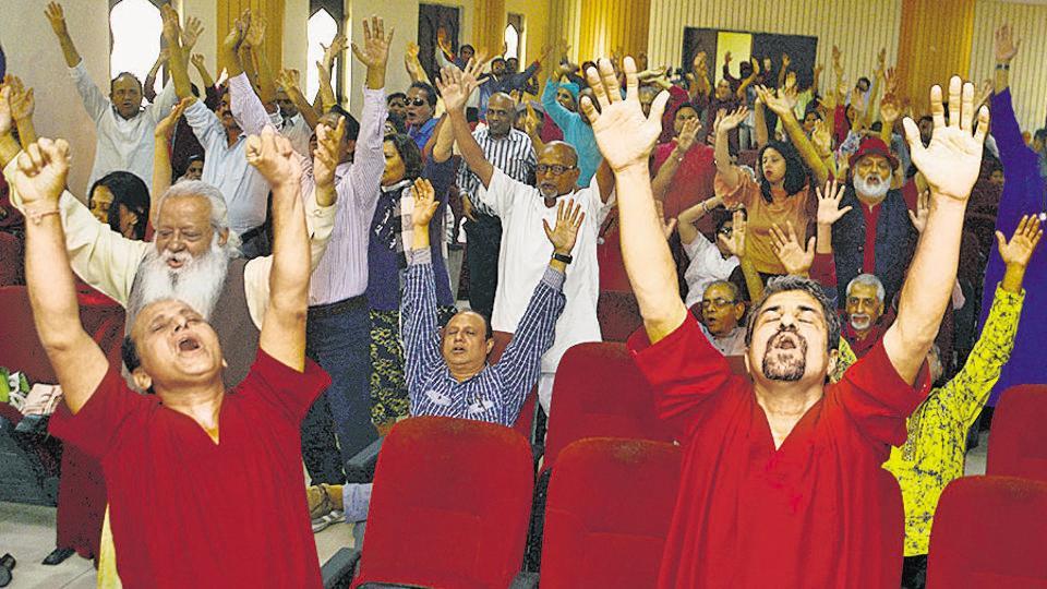 Followers of Osho dance as they celebrate Mahaparinirvana day in Pune