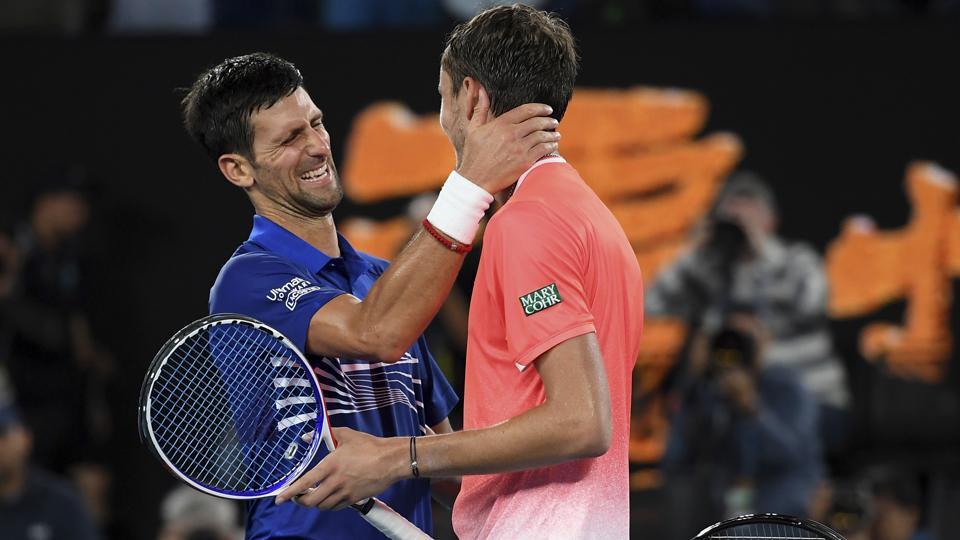 Serbia's Novak Djokovic is congratulated by Russia's Daniil Medvedev