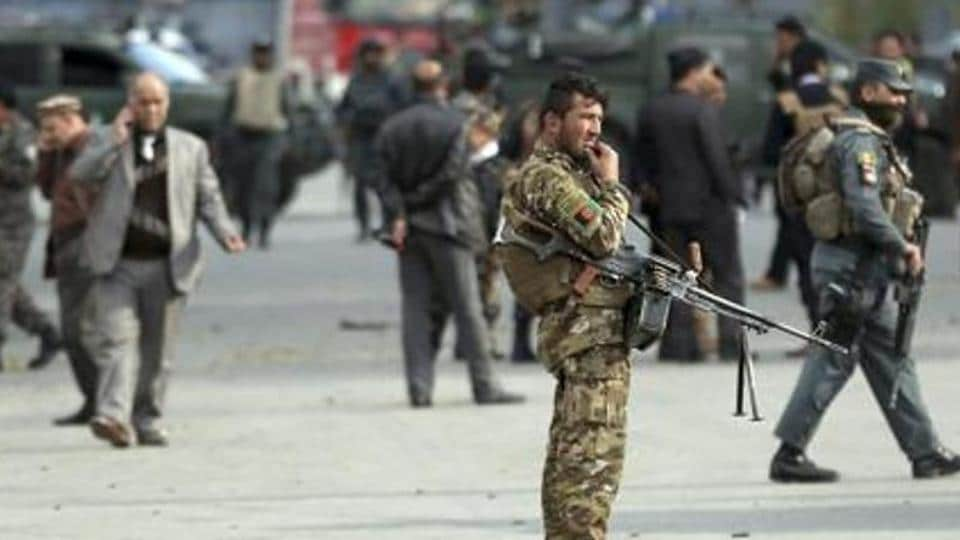 At least 12 people were killed Monday in a Taliban-claimed attack on a military compound in central Afghanistan.