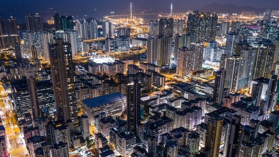 "Commercial and residential buildings in Hong Kong at night. He added: ""The city looks great at night and I spent a lot of time looking at Google Maps... so when I found a place to launch I had the shot in mind."" (Dale de la Rey / AFP)"
