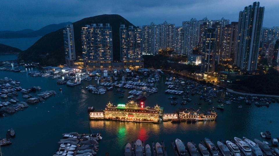 A floating restaurant in a marina in the Aberdeen area in Hong Kong. (Dale de la Rey / AFP)