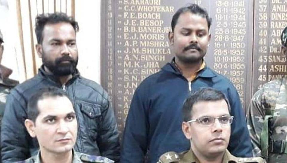 Police officials arrested Sumit Singh and his associate Sonu Lal (standing) for the murder of Jamshedpur-based broker Tapan Das on Saturday January 19, 2019.