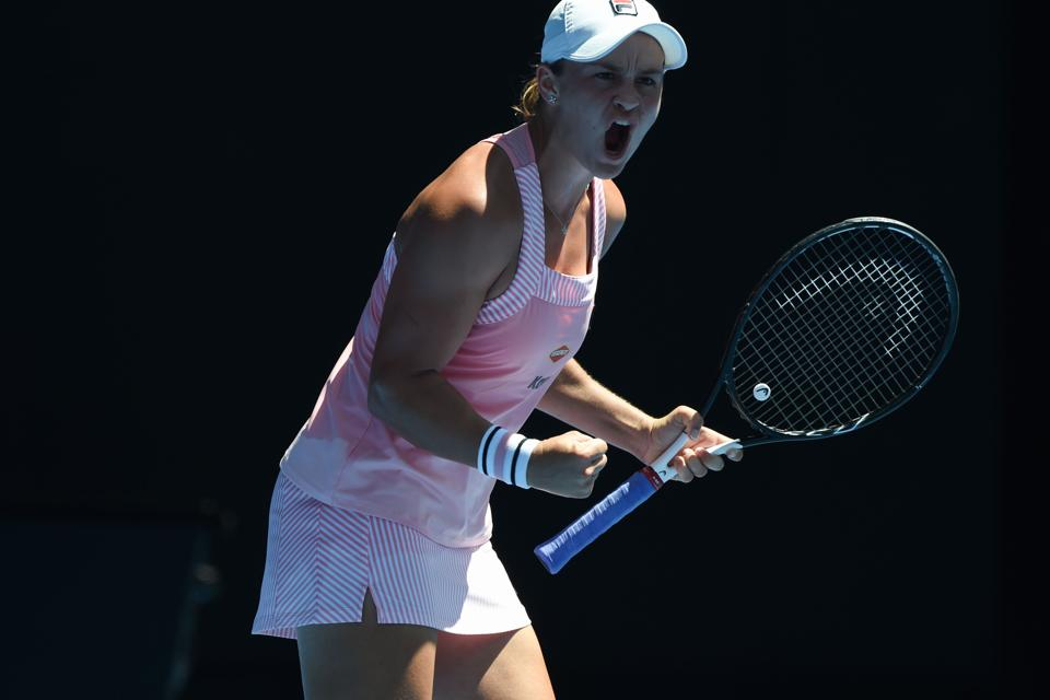 Australia's Ashleigh Barty reacts while playing against Russia's Maria Sharapova during their women's singles match on day seven of the Australian Open tennis tournament in Melbourne on January 20, 2019