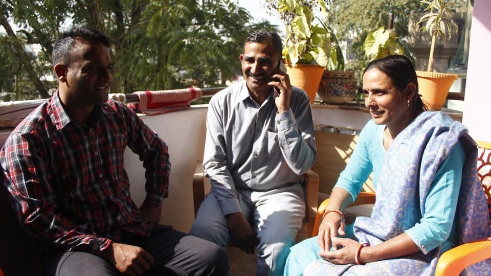 """Head constable Surinder Singh (C) basks in the sun with his family. """"This is my first weekly off in 16 years of service. I feel happy, almost like the time when I got married,"""" said the 49-year-old. Posted at Traffic Tower in Sushant Lok 1, he was among the 850 police personnel who got the first weekly off of their careers in the police force on Sunday. (Yogendra Kumar / HT Photo)"""