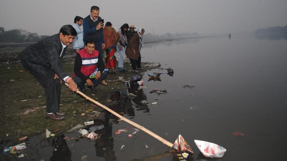 Activists of River Connect floating paper boats on Yamuna river on Tuesday.