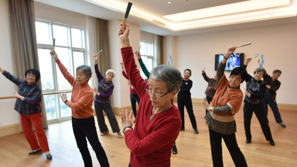 Residents taking a dance class. At Yanyuan, which is run by insurance giant Taikang, residents can either buy into the company's two million yuan ($290,000) pension plan or make a down payment of one to two million yuan ($145,000 to $290,000) on top of monthly living expenses of at least 6,000 yuan ($870), not including the food budget. (Greg Baker / AFP)