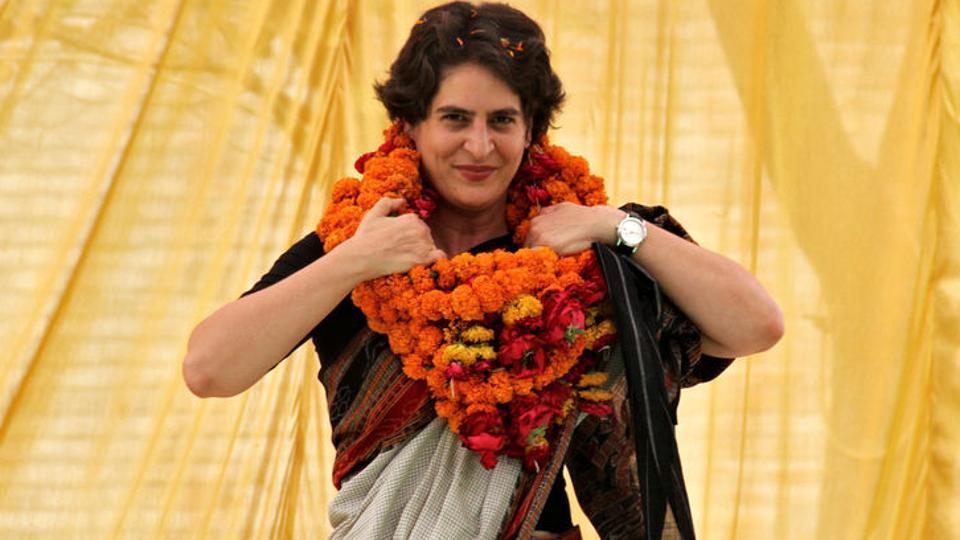 FILE PHOTO: Priyanka Gandhi Vadra adjusts her flower garlands as she campaigns for her mother Sonia Gandhi during an election meeting at Rae Bareli in Uttar Pradesh April 22, 2014. REUTERS/Pawan Kumar/File Photo