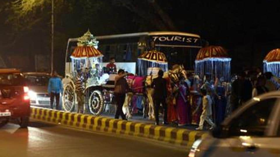 Police said the four, detained for dancing on top of a car's roof during a marriage procession, were let off with a warning.