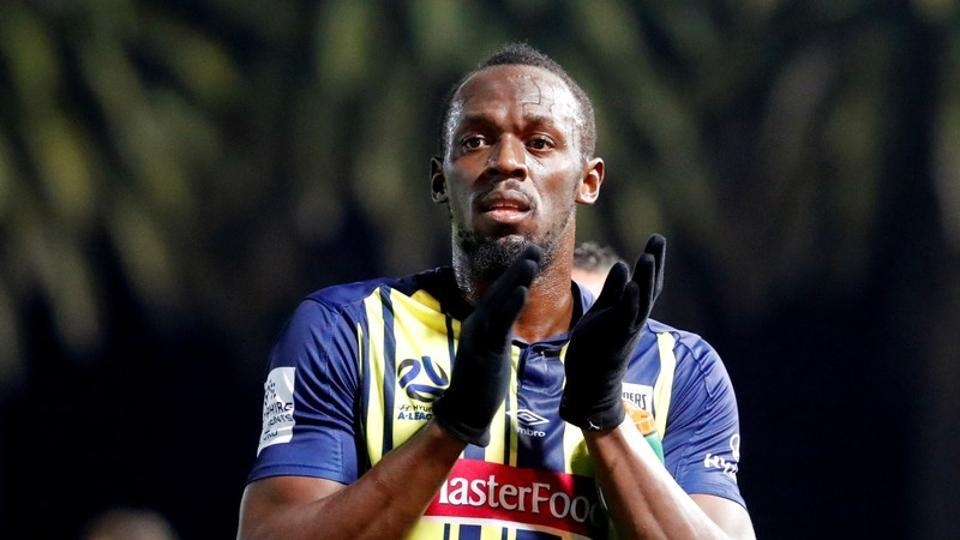 File image: Central Coast Mariners' Usain Bolt applauds fans after a match