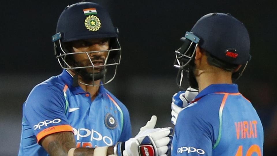 India's Virat Kohli, right, congratulates India's Shikhar Dhawan for scoring his half century. (AP)