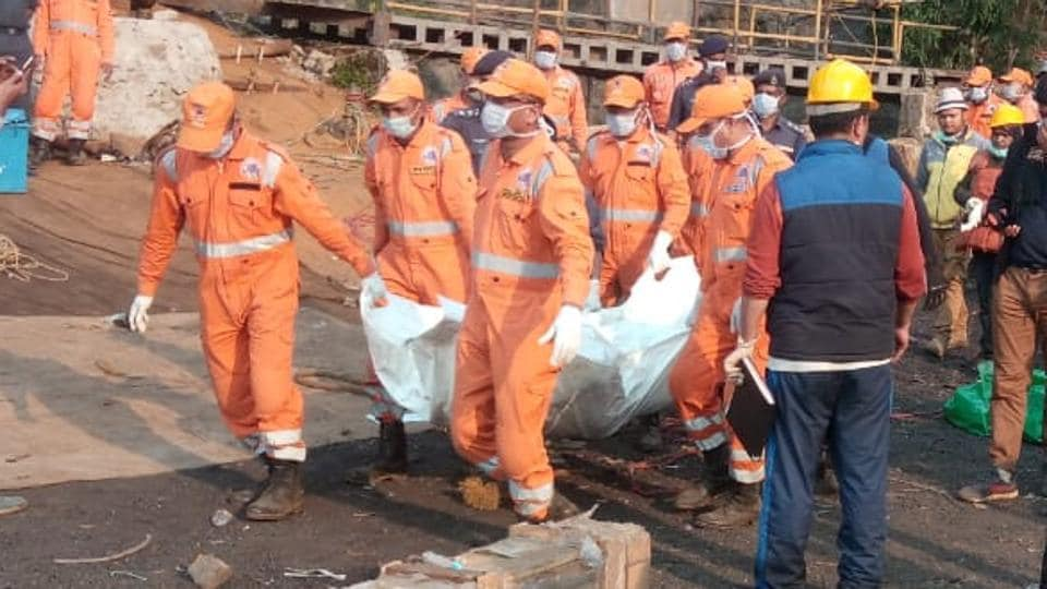 Rescuers manage to pull out the remains of a dead body which was spotted on January 16.