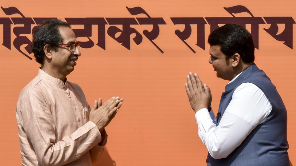 Maharashtra CM Devendra Fadnavis (right) greets Shiv Sena Chief Uddhav Thackeray at an event in Dadar, on Wednesday.