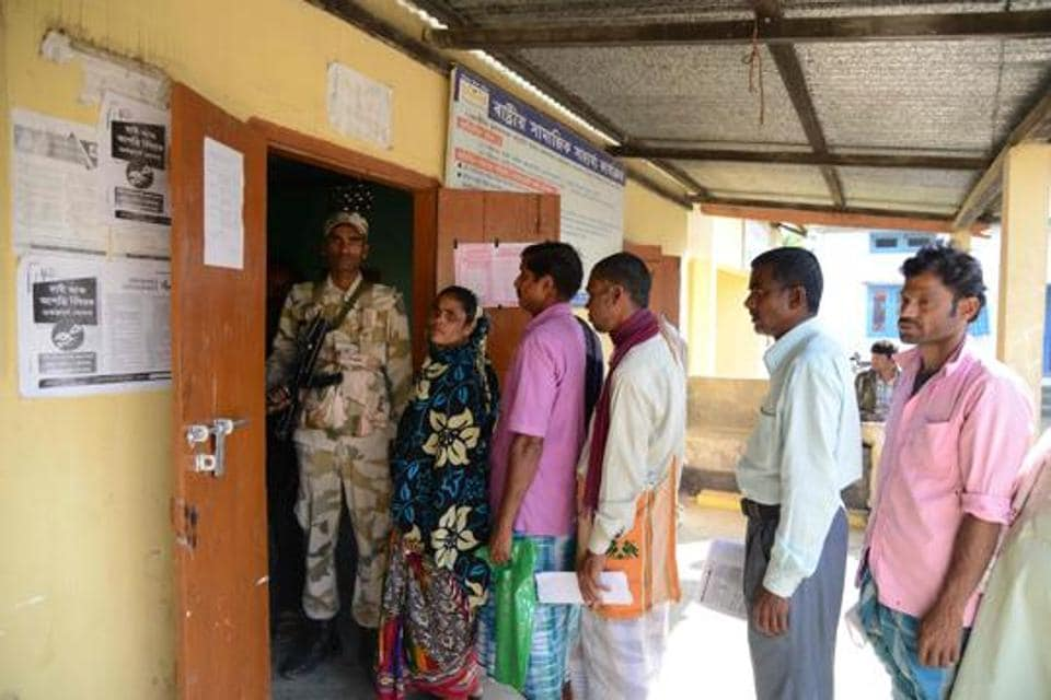 In this photo taken on December 8, 2018, villagers gather to check their documents at a National Register of Citizens (NRC) help centre for people whose names were not featured in the final draft of the NRC at Hatisola village in Kamrup district in India's northeastern Assam state.
