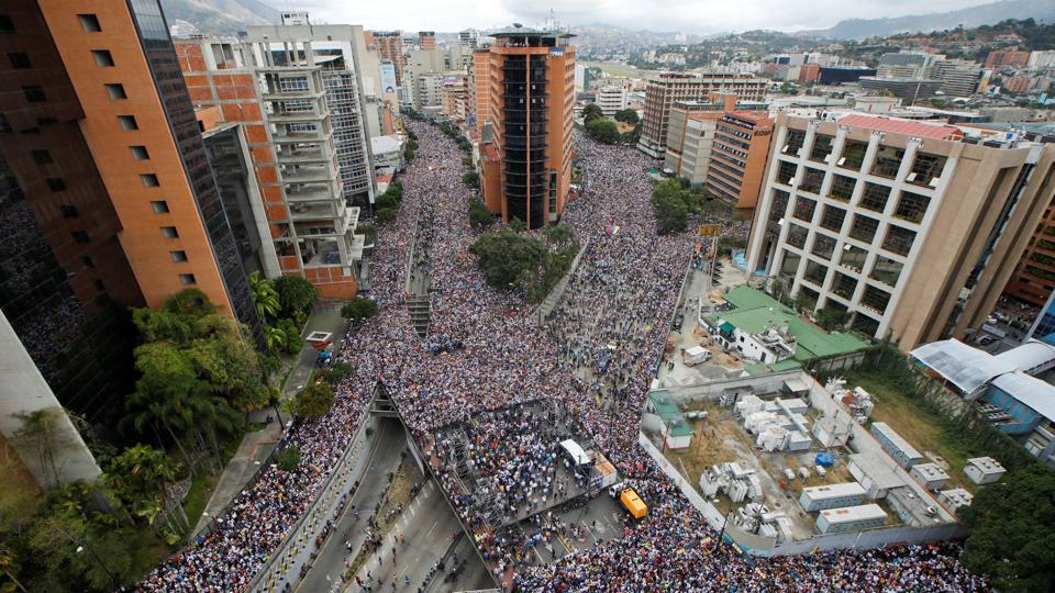Tens of thousands of protesters took to the streets of Caracas and other cities in rival demonstrations for and against Maduro on January 23. The National Assembly had called an opposition rally against Maduro to mark the anniversary of the 1958 fall of the military dictatorship of Marcos Perez Jimenez. (Adriana Loureiro / REUTERS)