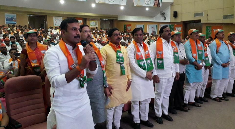 Girish Bapat(second from left), guardian minister for Pune district, along with BJP workers during the 'live' conference with PM Narendra Modi in Baramati on Wednesday.