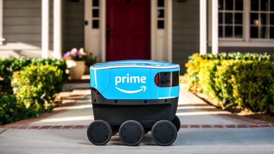 Amazon's new delivery robots can guide themselves along sidewalks at a walking pace