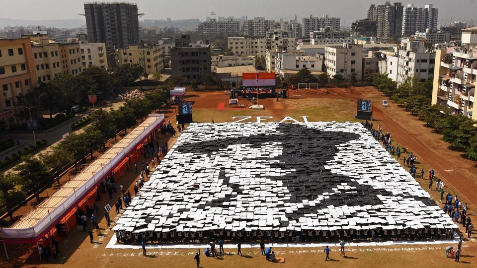 Students of Zeal institute create a formation of India's freedom fighter, Bhagat Singh on the eve of 70th Republic Day of India in the college premise on Friday. The formation was created by 3,536 students and was a successful attempt to create a record in Golden Book of World Records. (Pratham Gokhale/HT Photo)
