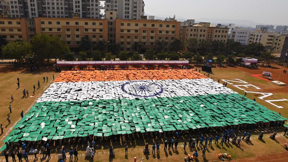 Students of Zeal institute create a formation of India's national flag on the eve of 70th Republic Day of India in the college on Friday. The formation was made with the help of 3,563 painted card boards each with a size 2.5 x 2.5 feet. (Pratham Gokhale/HT Photo)
