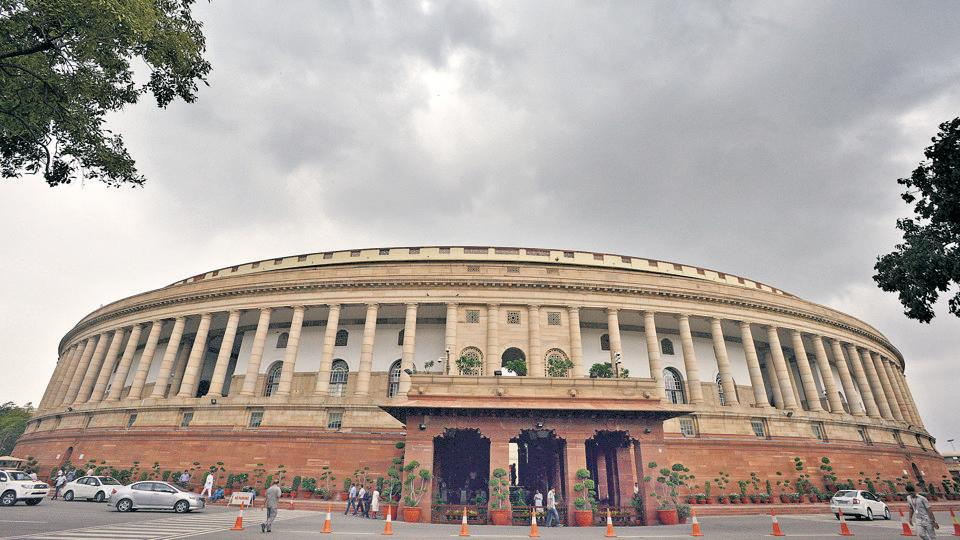 Dense clouds covers the capital's skyline, the Parliament House, in New Delhi.