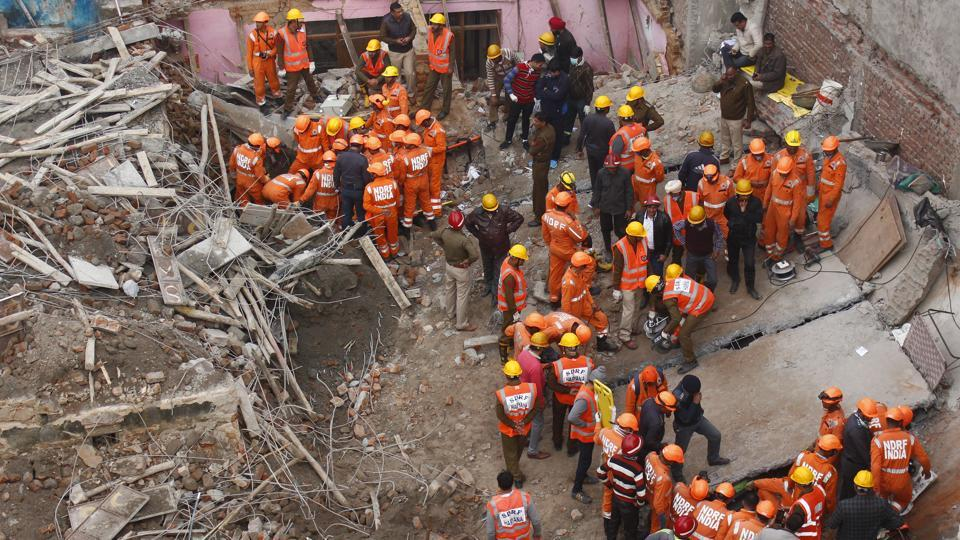 Rescue teams work at the site of the collapse of an under construction four-storyed-building in Ullahawas village, Gurugram. (Yogendra Kumar / HT Photo)