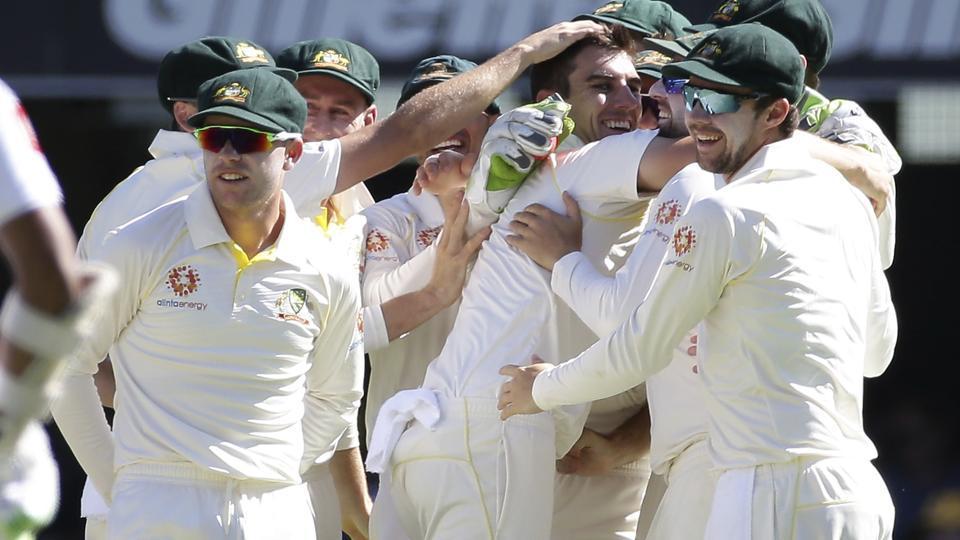 Australia's Pat Cummins, center, celebrates with his team after he got the wicket of Sri Lanka's Lahiru Thirimanne.