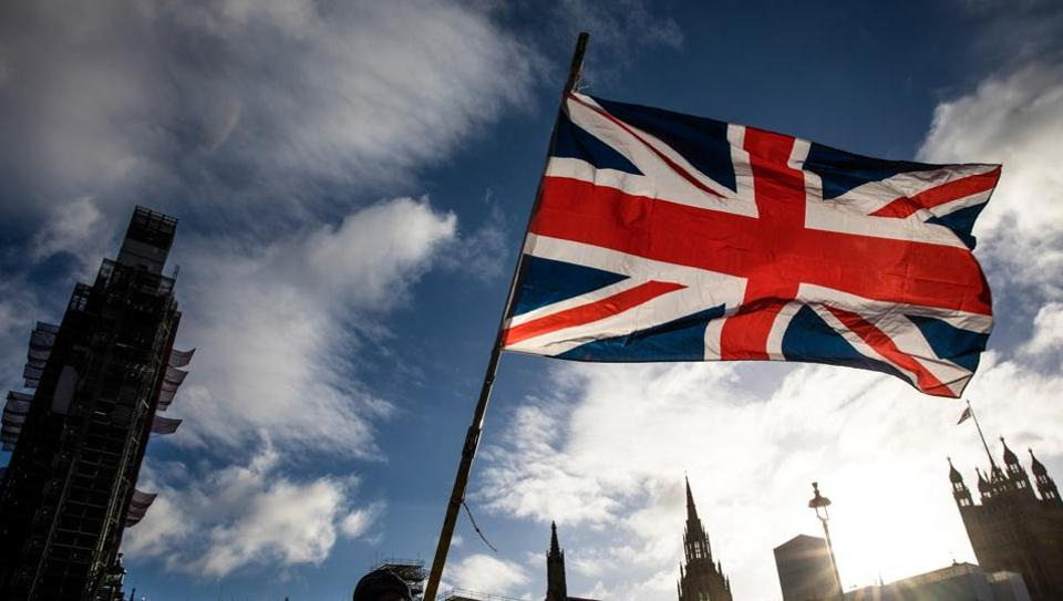 British Union Flag, also known as a Union Jack, outside the Houses of Parliament in London.