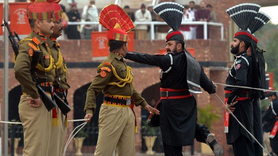 Border Security Force personnel in brown uniforms and Pakistani Rangers in black uniforms perform during the Beating Retreat ceremony at the India-Pakistan Wagah-Attari border post, about 35 kms from Amritsar, Punjab. (Narinder Nanu / AFP)