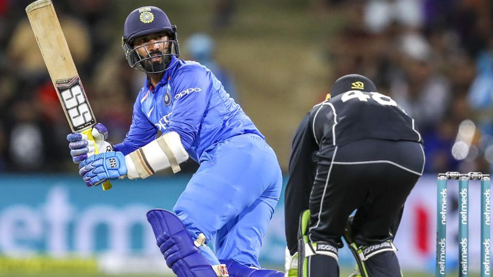 India's Dinesh Karthik, left, plays a shot against New Zealand (AP)