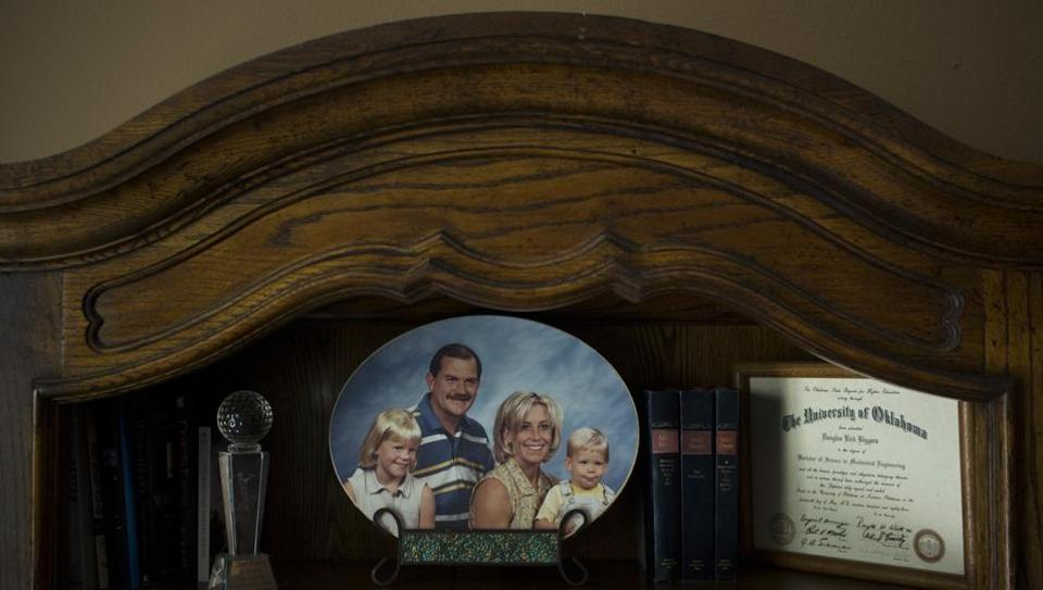 Landon Biggers sits on his mother's lap in an old family photo in his father's home office in La Quinta, California. Biggers became one of 70,237 Americans dead from opioids overdose in 2017. The death count from opioids alone has climbed higher than 400,000 lives as the epidemic enters its third decade. For families like this one, the scars of the crisis will endure far longer. (Jae C. Hong / AP)