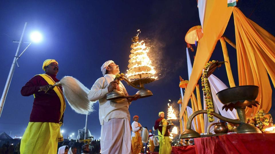 A priest performs Ganga Aarti, at the bank of river Ganga, during the ongoing Kumbh Mela-2019, in Allahabad, Monday.