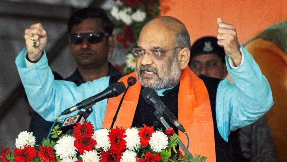 "Bharatiya Janata Party (BJP) National President Amit Shah addresses a 30,000 booth-level party workers conference at Kulia, in Niutao district. Amit Shah slammed West Bengal Chief Minister Mamata Banerjee on refusal to fund Ayushman Bharat scheme. ""She stopped funding it since she was afraid that it will encourage people to vote for Modi,"" Shah said. (PTI)"
